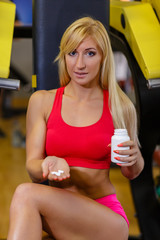 Sports woman and nutritional supplements.