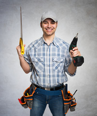 Portrait of a smiling carpenter. Gray grunge background