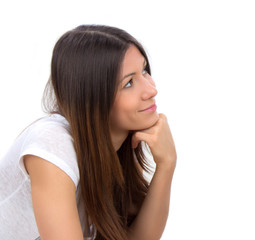 Portrait of happy young brunette woman thinking