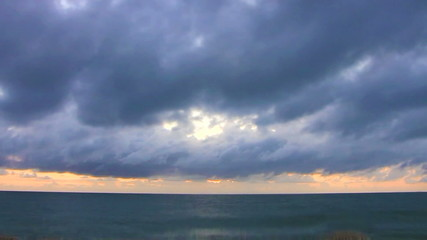 Sunrise time-lapse partial cloudy sky over the sea