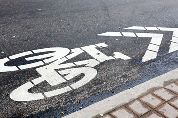 Bicycle symbol on road in a street