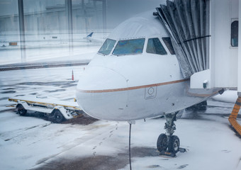 Air plane in winter weather at an airport