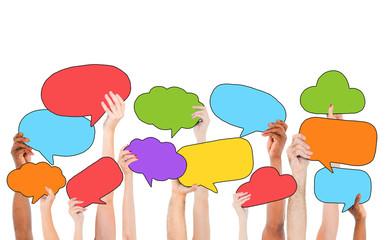 People Holding Multicolored Speech Bubbles Cloud Symbols Concept
