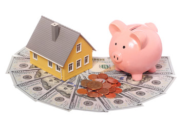 Tiny house, piggy bank and money isolated. Mortgage Concept