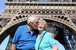 Senior couple in front of Eiffel Tower