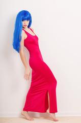 Portrait of beautiful woman in  blue wig