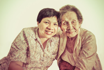 Family Portrait of an Asian elder mother and daughter hugging in