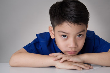 portrait of asian cute boy sad and  looking very disappointed
