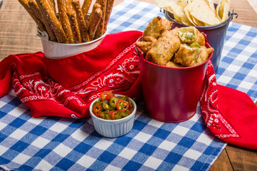 Jalapeno peppers and chips for snack