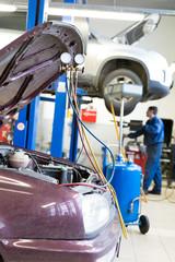 Refilling car air conditioner in vehicle service repair workshop