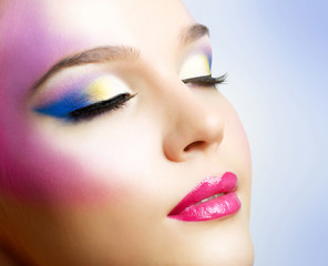 Beautiful girl with fashion bright makeup