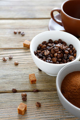coffee beans in a bowl and cup