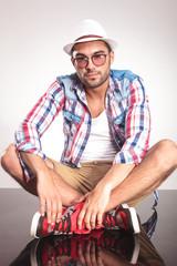 Fashion man sitting on the floor