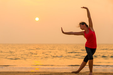 sunset in orange tones and woman yogas