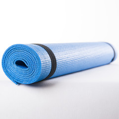Blue mat for fitness on a white background.
