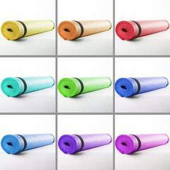 Colored mats for fitness on a white background.