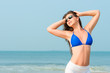 Slim pretty girl in sunglasses enjoying the sun