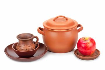 earthen pot, jug, plate and ripe apple
