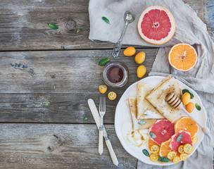 Spring vitamin breakfast set. Thin crepes or pancakes