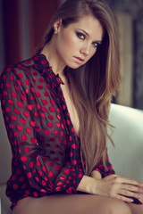 Beautiful sexy lady in pink blouse
