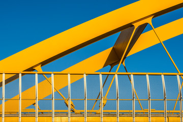 yellow steel blue sky
