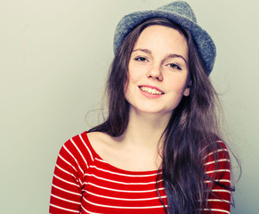 Woman in hat hipster in stripes clothes smiling cute