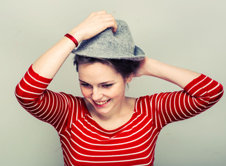 Woman in hat hipster in stripes clothes smiling