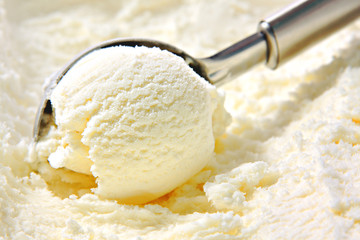 Vanilla ice cream scooped out of container