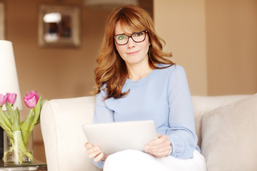 Attractive woman with digital tablet at home