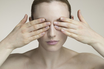 Women who are blocking the eyes by hand