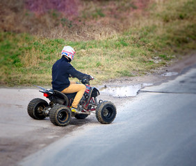 Young man on a quad