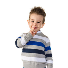 Kid making silence gesture