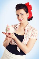 lachendes Pinup Girl mit Sparschwein