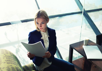 Attractive business woman read some documents before meeting