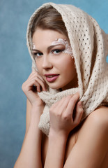 beautiful caucasian young woman with pearl glamour make-up
