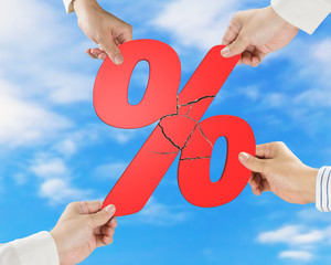 Group of business people assembling broken red percentage with s