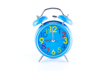 Alarm Clock isolated on white, in blue, showing nine o'clock.