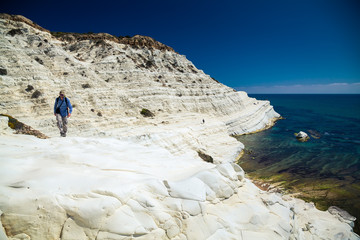 man walking at the Scala dei Turchi