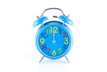 Alarm Clock isolated on white, in blue, showing twelve o'clock.