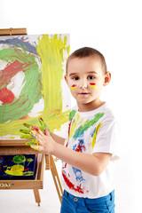 Little boy paints a picture
