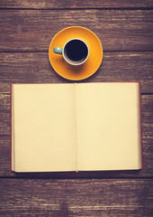 Cup of coffee and opened book