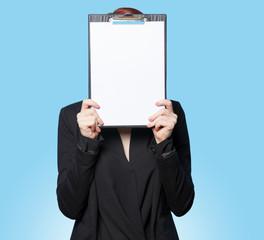 Business women hiding behind tablet