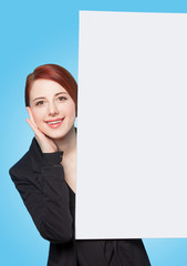 Happy redhead women with white board