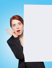 redhead women with white board