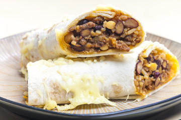 burrito filled with beef minced meat and beans baked with gouda