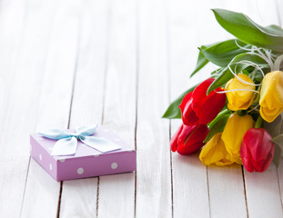 Gift box and bouquet of flowers