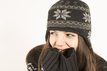 Happy young woman wearing warm winter clothing smiling