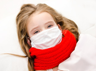 Little girl with surgical face mask for bacterial