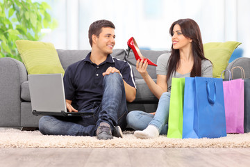 Woman showing her new shoes to boyfriend