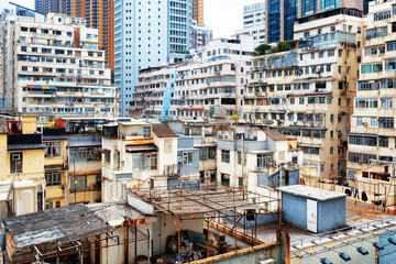 Old houses surrounded modern skyscrapers in Hong Kong